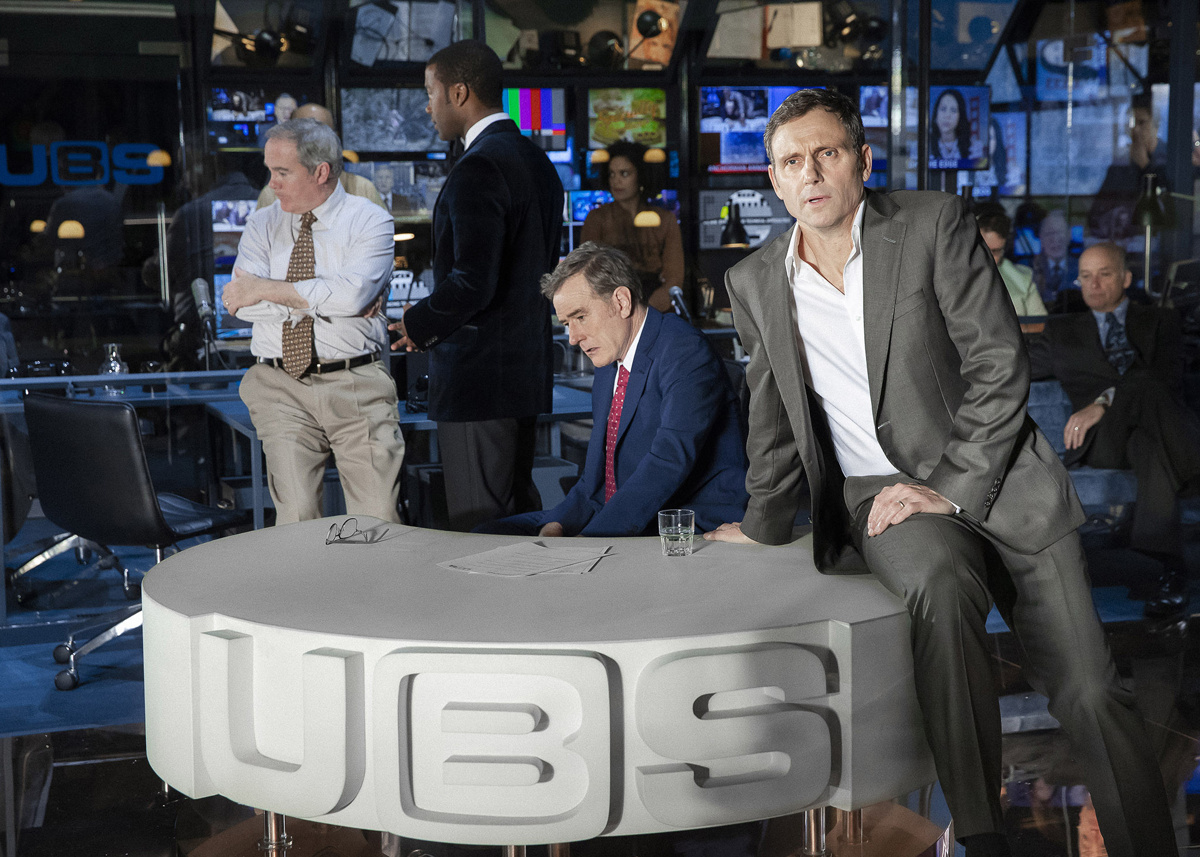 Bryan Cranston as Howard Beale, Tony Goldwyn as Max Schumacher and the cast of Network.