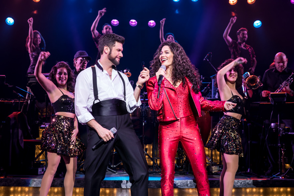 Mauricio Martinez as Emilio Estefan, Christie Prades as Gloria Estefan and the company of the national tour of On Your Feet.