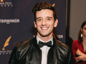 The evening's host Michael Urie is all smiles.