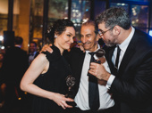 The Band's Visit star Katrina Lenk hugs producer Orin Wolf and the movie's original Tewfiq, Sasson Gabai.