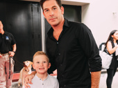A Bronx Tale star Richard H. Blake and son pose for the camera.