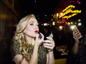 Pucker up! Lora Lee touches up her lipstick at the after-party.