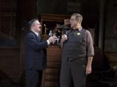 Nathan Lane as Walter Burns and John Goodman as Sheriff Hartman in The Front Page.