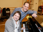 Groundhog Day's music director Christopher Nightingale and orchestrator David Holcenberg pose by the piano.