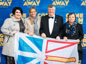 Wave that flag! Kelly Scevior, fellow Newfoundlander, Mayor Claude Elliott & Gerri Elliott celebrate opening night.