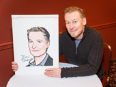 The Present star Richard Roxburgh poses with his Sardi's caricature after signing it.