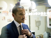 Big shot! Jon Jon Briones suits up for the opening night party.