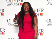 She's not goin'! Dreamgirls star Amber Riley strikes a pose with her Olivier Award for Best Actress in a Musical.(Photo: Getty Images)