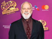 Charlie and the Chocolate Factory's John Rubinstein takes a photo.
