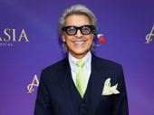 Broadway legend Tommy Tune flashes a smile.