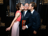 Mwah! Laura Osnes and Aaron Tveit celebrate William Ivey Long's Lifetime Achievement Award with a smooch. The legendary costume designer dressed them for Cinderella and Grease: Live, respectively.