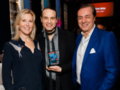 The John Gore Organization's Chief Operating Officer Lauren Reid and CEO and Chairman John Gore celebrate Jujamcyn President Jordan Roth's BACA Best Revival win for Falsettos.