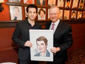 Sardi's owner Max Klimavicius presents Karl with his caricature.