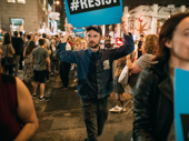 Tom Sturridge marches in New York City.