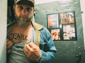 Joe Tippett shows off his Earl tattoo.