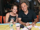 The couple that autographs together! Theater couple Rebecca Luker and Danny Burstein take a photo.