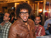 E Street band saxophonist Jake Clemons, the son of legendary sax player Clarence Clemons, takes a photo.