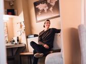 Evan Todd hangs in his dressing room.