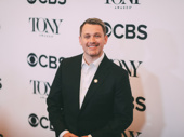 Once On This Island's Tony-nominated director Michael Arden flashes a smile.
