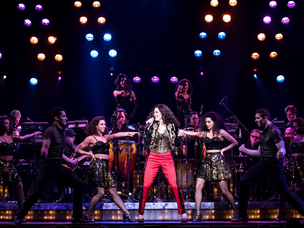 Christie Prades as Gloria Estefan and the company of the national tour of On Your Feet.