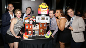 Former Avenue Q Jed Resnik, Maggie Lakis,  Jason Jacobs, Rob McClure, Carmen Ruby Floyd and Matt Dengler celebrate with a cake by Cute As Cake.