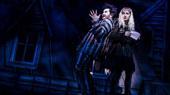 Alex Brightman as Beetlejuice and Sophia Anne Caruso as Lydia in Beetlejuice.