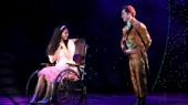 Mili Diaz as Nessarose & Michael Wartella as Boq in Wicked