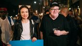 Olivia Wilde and Michael Moore take it all in.