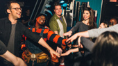 Hands in! Avenue Q's Jed Resnick , Danielle K. Thomas, Nick Kohn and Kerri Brackin get psyched before they hit the stage.