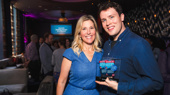 Broadway Across America Chief Operating Officer Lauren Reid and Grey Henson proudly show off the Mean Girls star's award for Favorite Featured Actor in a Musical.