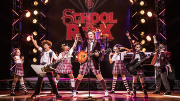 Eric Petersen as Dewey and the cast of School of Rock.