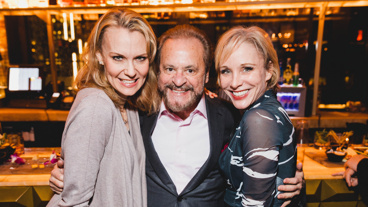 Chicago's current Velma Leigh Zimmerman and Roxie Charlotte d'Amboise pose with producer Barry Weissler.