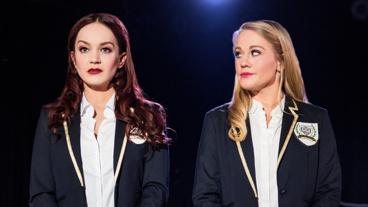 Lauren Zakrin as Kathryn and Carrie St. Louis as Annette in Cruel Intentions.