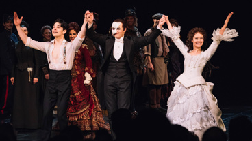 The Phantom of the Opera's Rodney Ingram, Peter Jöback and Ali Ewoldt take their curtain call.