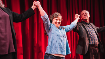 Amy and the Orpans star Jamie Brewer is all smiles for her opening night bow.