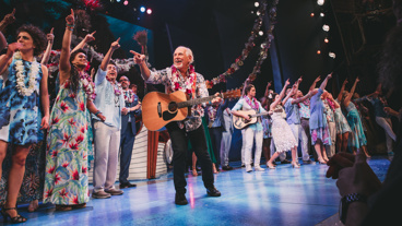 Jimmy Buffett joins the cast onstage.